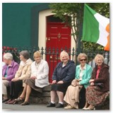 01 'Cumann na mBan' on Brennan's wall awaiting the Corpus Christi Procession 26th June 2011